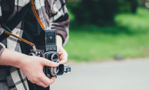 Photographer looking through a vintage camera