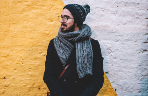 Man bundled up with scarf and wool hat