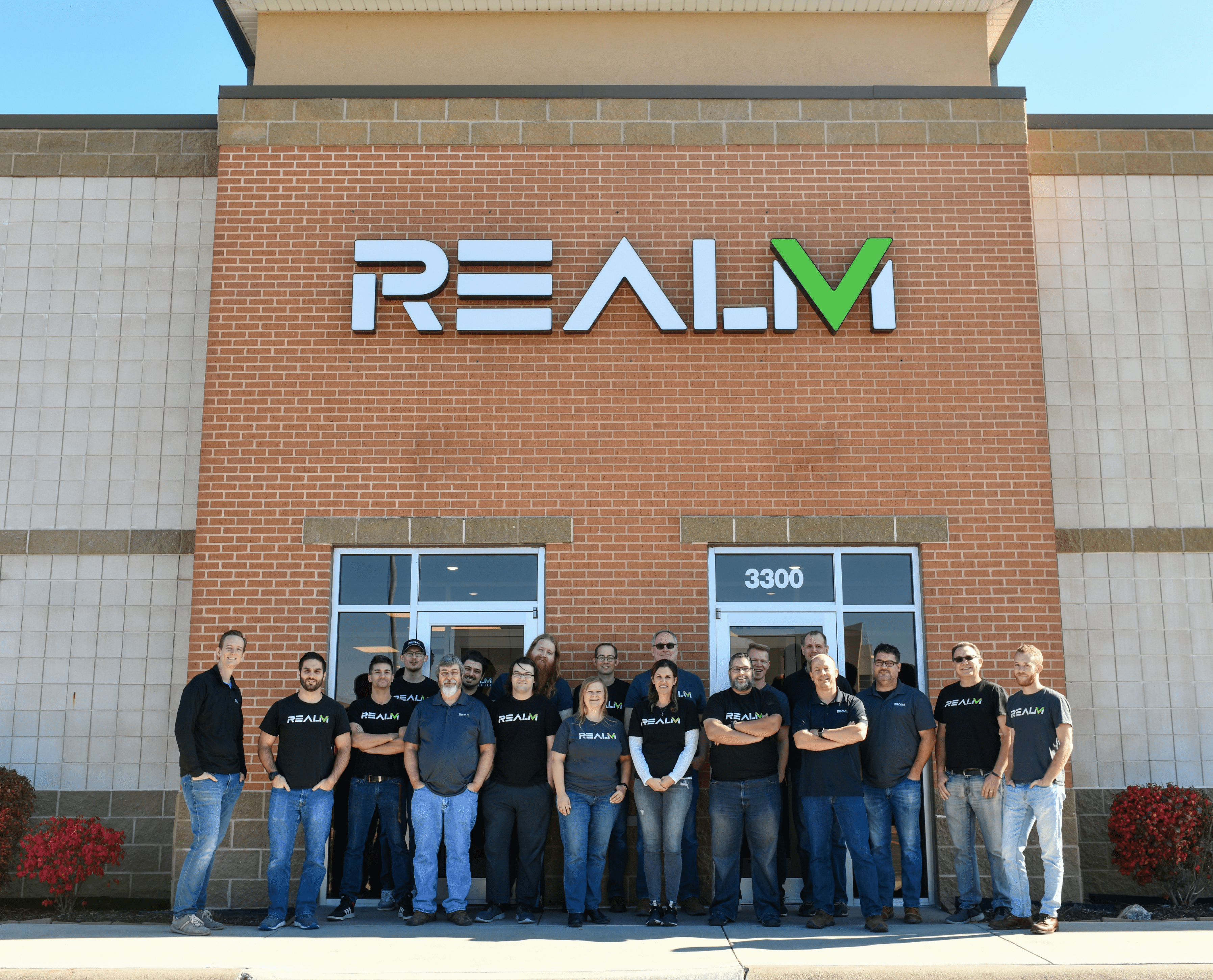 RealmFive team outside the RealmFive building
